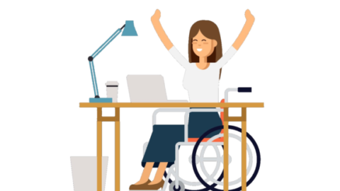 Disabled young woman in wheelchair working with computer
